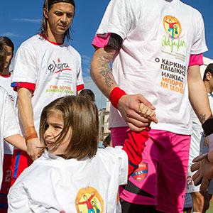Λάμψη & Φλόγα <span></span>[σύλλογοι]<span>T-shirts προώθησης της «Παγκόσμιας ημέρας κατά του παιδικού καρκίνου» σε αγώνες της Superleague</span>